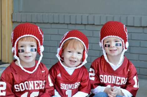 No question who these brothers are rooting for! OU Helmets by Breanna Brummer