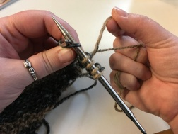 Continue to twist the yarns around each other as you work along the row.