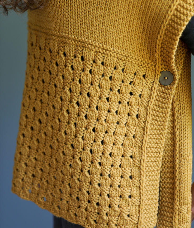 detail of acorn lace stitch in the happy harvest poncho