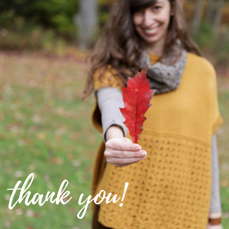 """photo of Elizabeth Smith holding a red leaf while modeling the Happy Harvest set, with the words """"thank you"""" on the image"""
